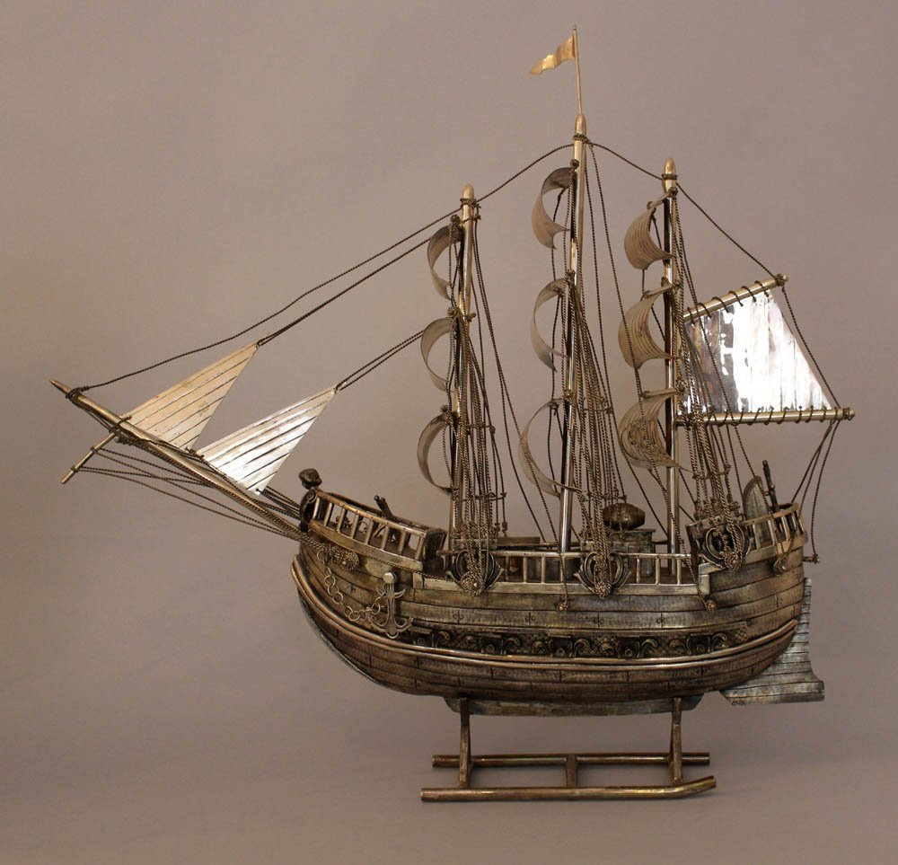 Large silver ship or galleon with ten cannons, seals, s