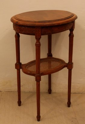 French Small Side Table In Oval Shape On Four Legs,