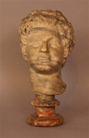 Marble head of a smiling Bachus in ancient Roman manner;