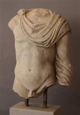 Wide marble torso of a Roman male nude with toga in