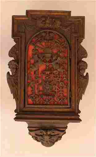Flemish cupboard with one door and carved angels on the