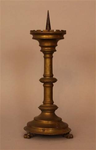 Bronze candle stick in medieval style, turned form on