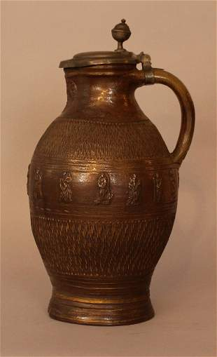 German apostles jug in shaped form with carved