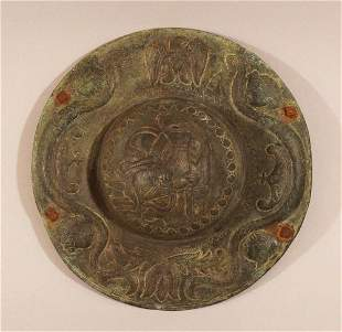 A round bronze shield in ancient manner with a moulded