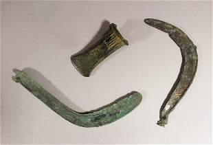 Lot comprising two ancient bronze sickles and a bronze