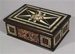 A French or Spanish ebony and ivory casket with red