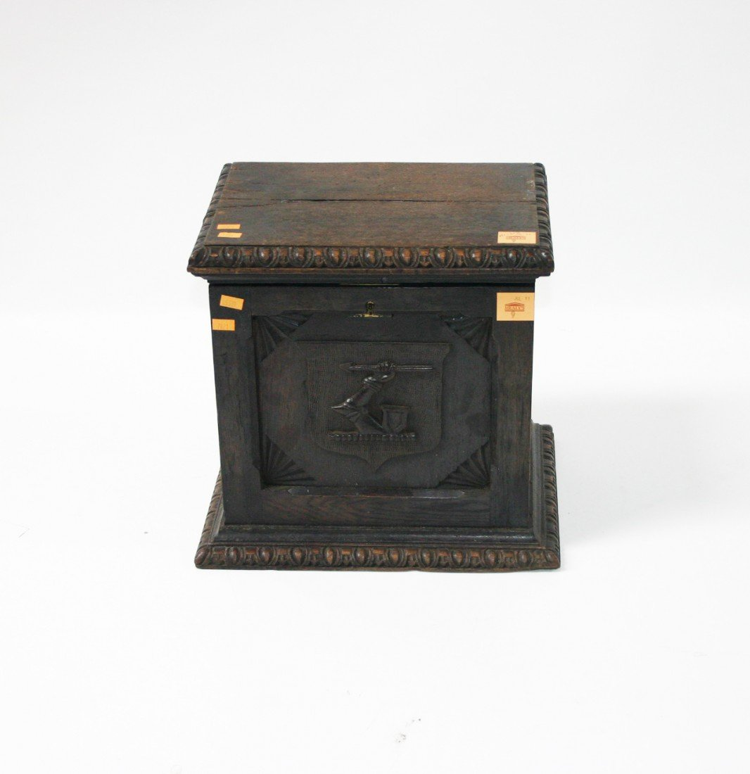 9: A crested oak Decanter Box, 19th Century, with egg a