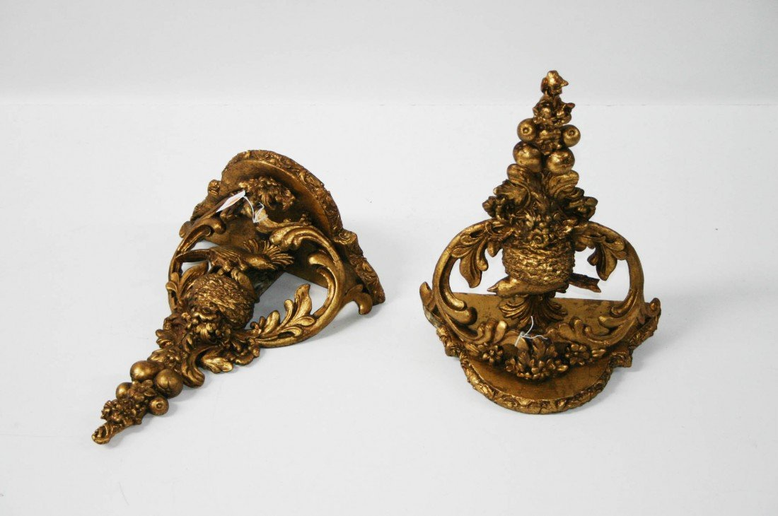 19: A pair of gilt gesso Wall Brackets, each with a ser