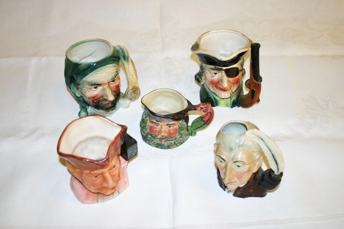 4: A collection of porcelain Toby Jugs, various factori