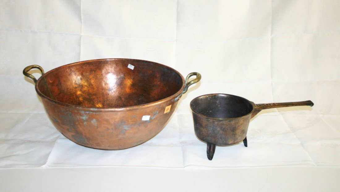 "19: A heavy two handled copper Preserving Pan, 25"" (64c"