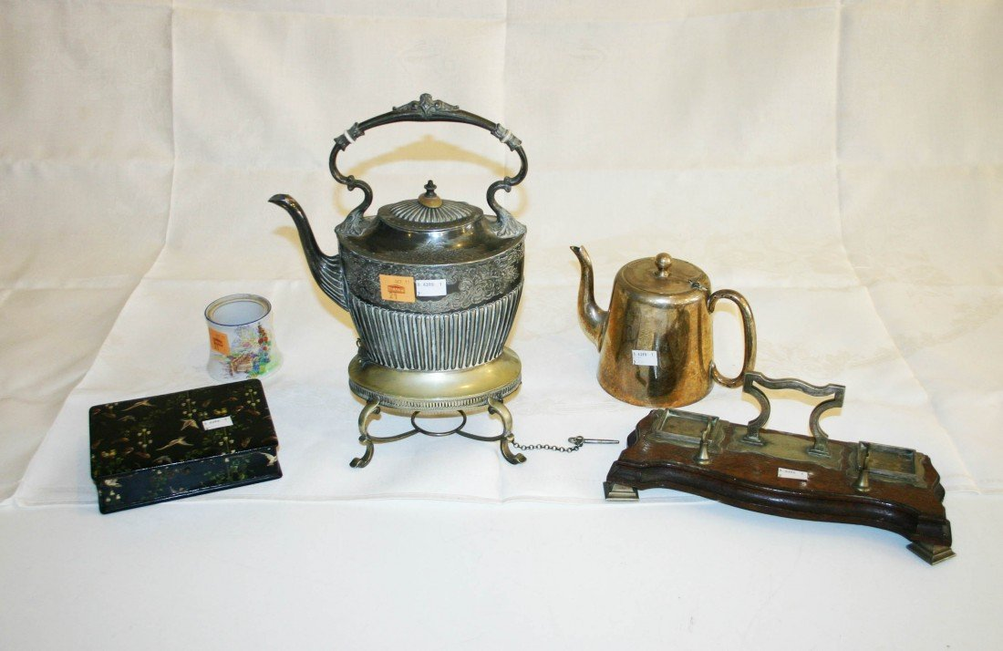 21: A silver plated Tea Kettle and stand, a plated Ewer