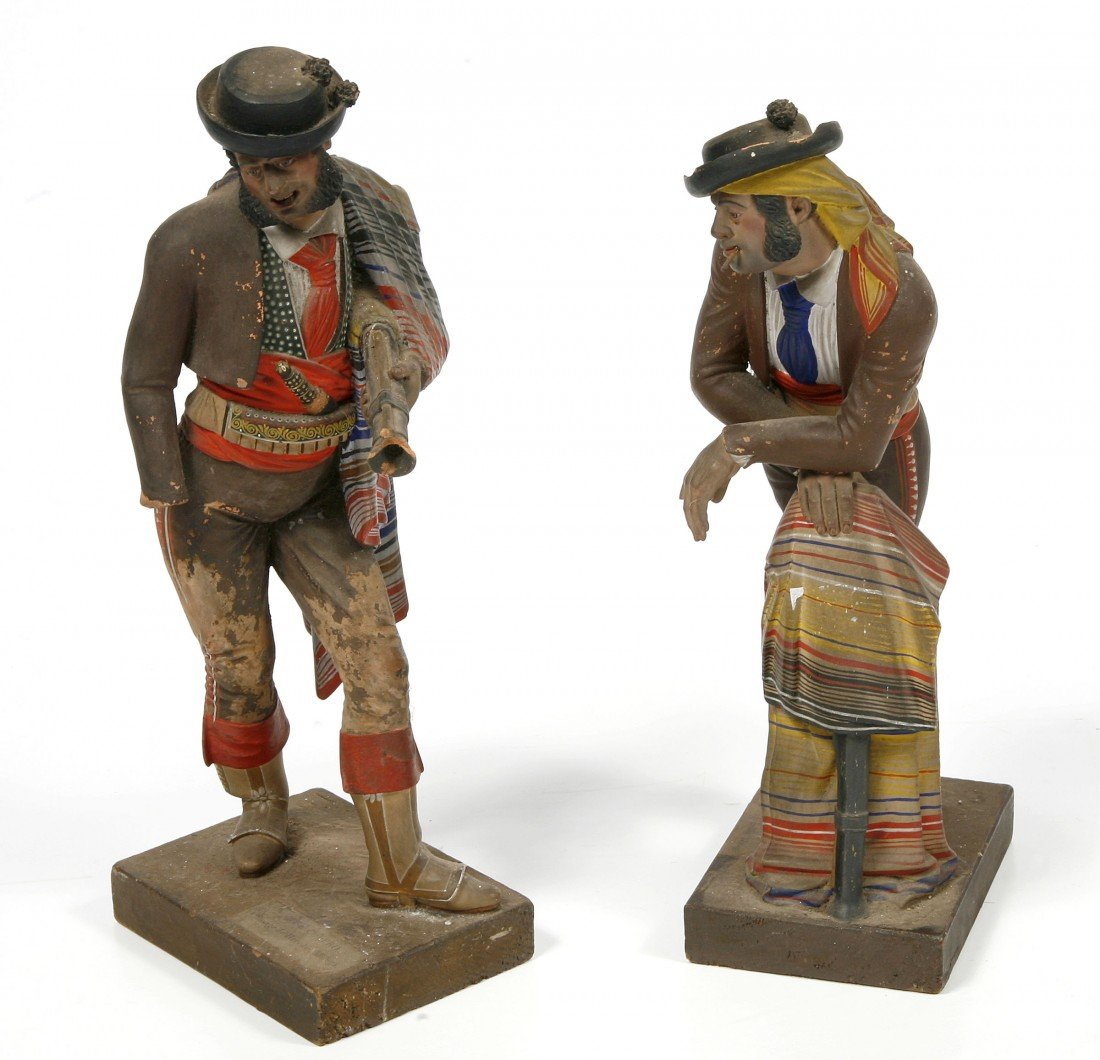 306: A pair of Spanish painted terra-cotta Figures, 19t