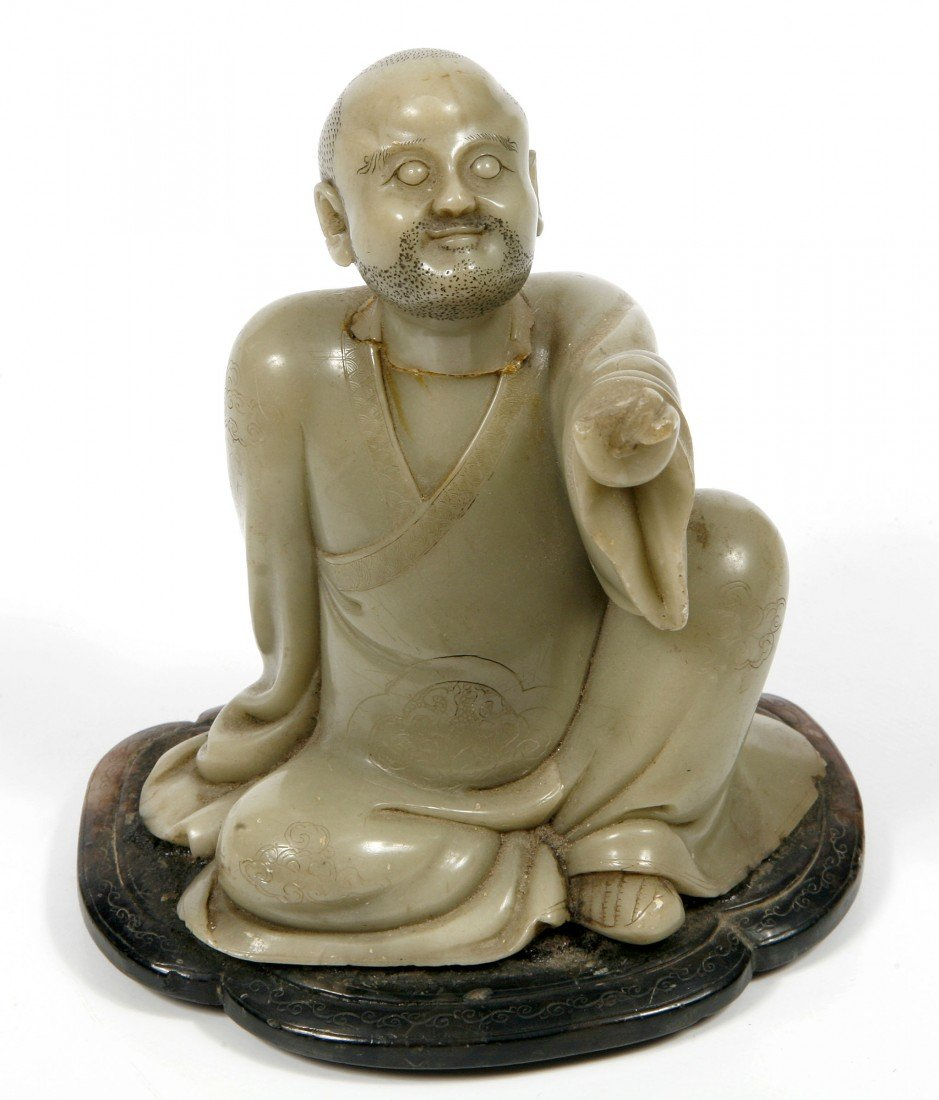 458: A carved green soapstone Figure, of a Chinese Begg