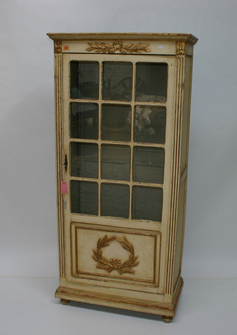 607: A cream painted and parcel gilt vitrine cabinet,