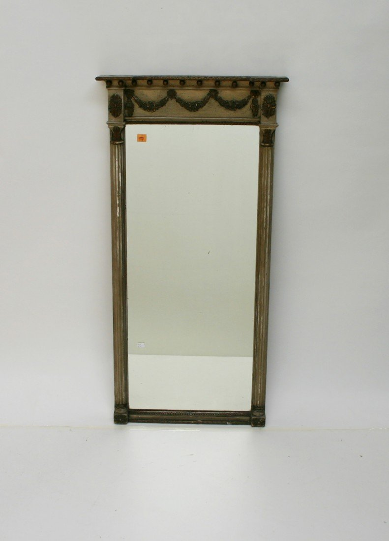 612: A grey painted and parcel gilt pier mirror,  the i