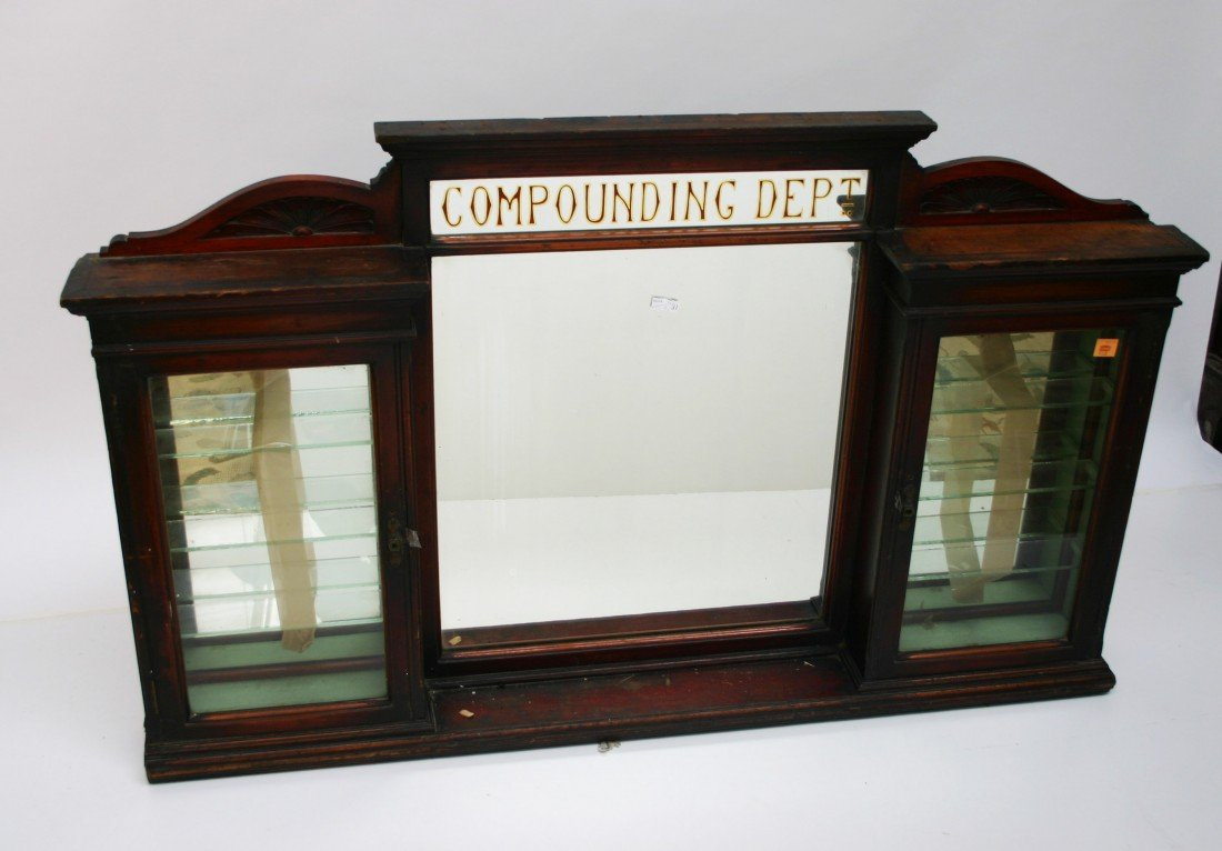 622: A chemist's wall display case, early 20th century,