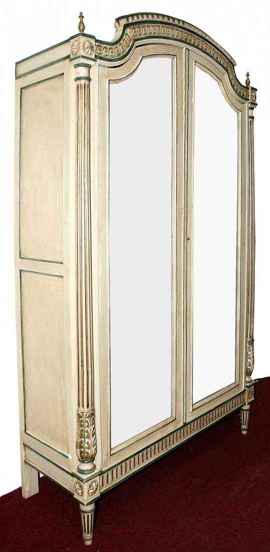 624: A cream parcel gilt and green painted armoire or w