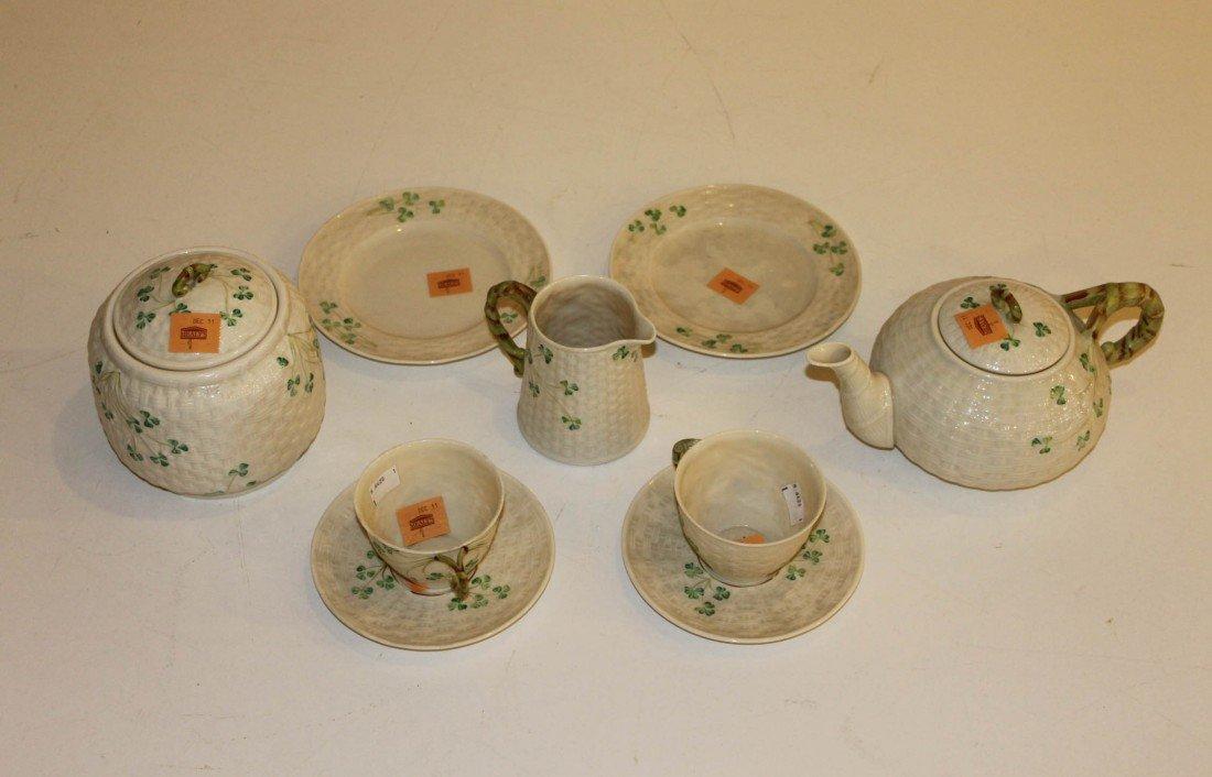 1: An eleven piece Belleek basket moulded Tete-Tete Tea