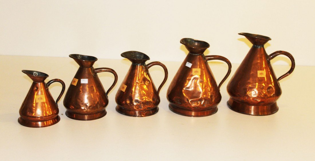6: A set of 5 graduating copper Measures, one stamped D