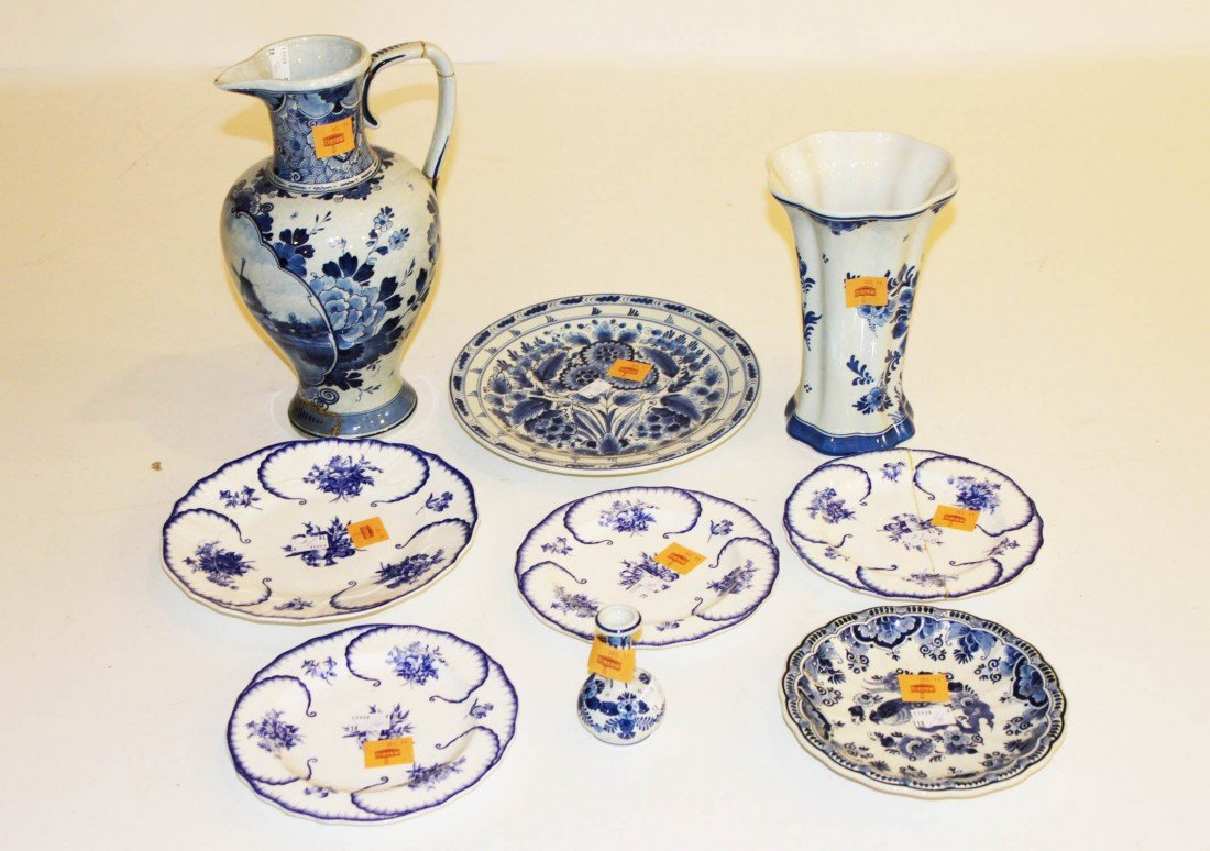 8: A blue and white delft Ewer, of baluster form, a blu