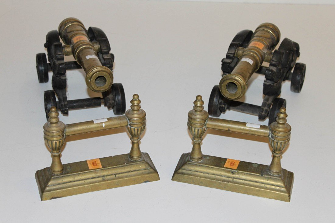 14: A pair of heavy brass and cast iron floor cannons,