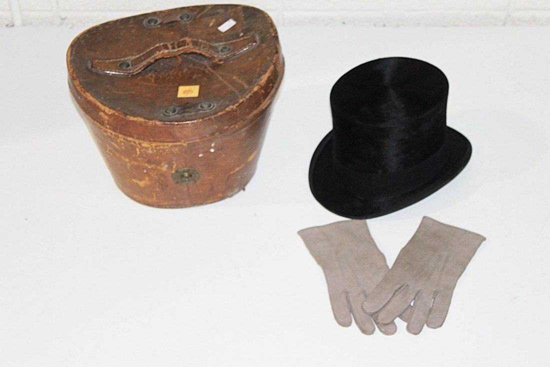 18: A cased Top Hat and Gloves.