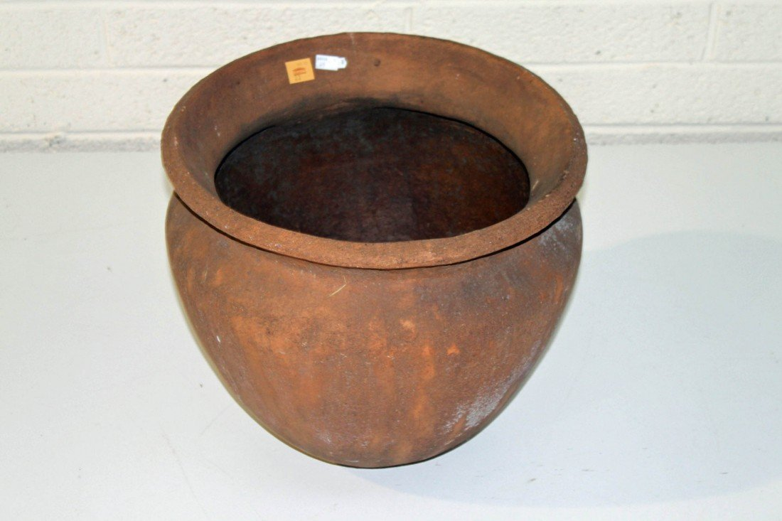 23: A pair of large terracotta baluster shaped planters
