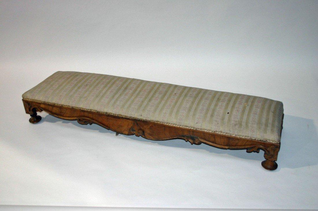702: An oblong slope top walnut Fender Stool, Victorian