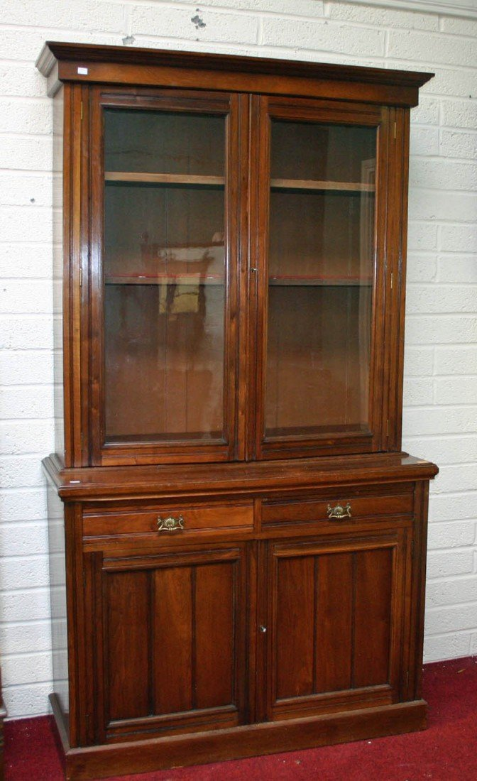 704: A walnut bookcase, Edwardian, with moulded cornice