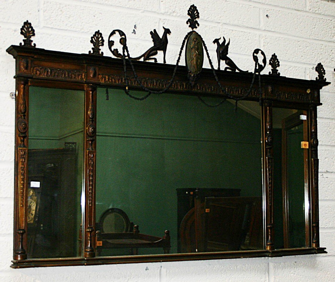 708: A gilt Overmantel, in the Regency style, crested w