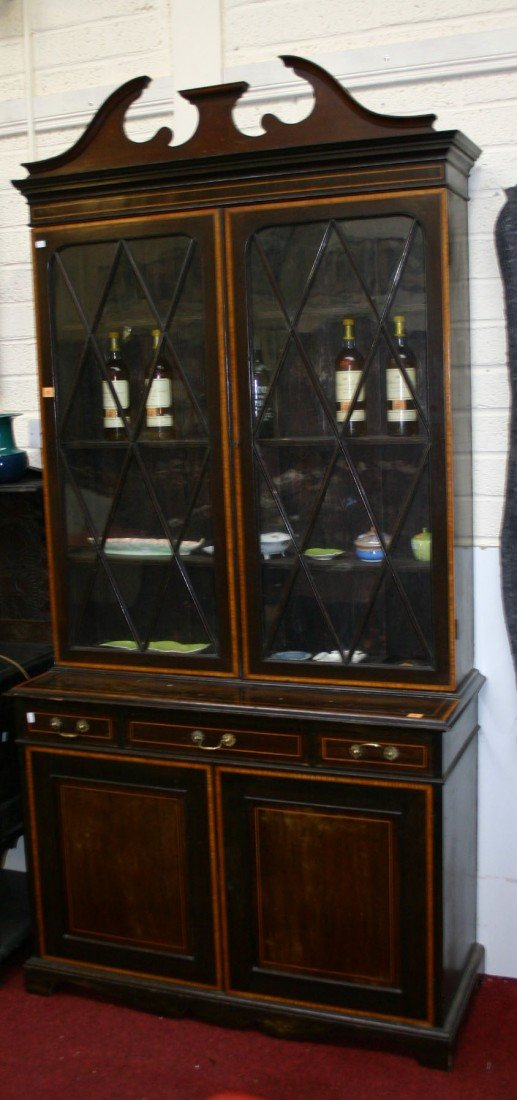 709: An inlaid and crossbanded mahogany Bookcase, Edwar