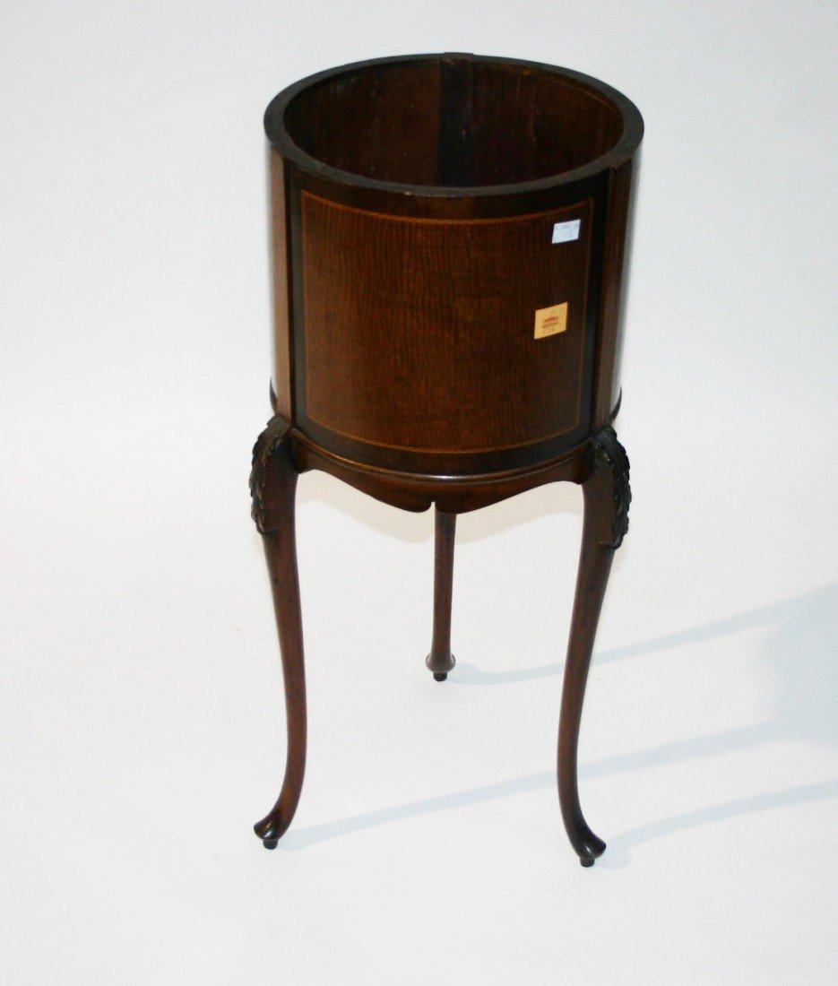 714: A circular fiddle back mahogany and inlaid jardini