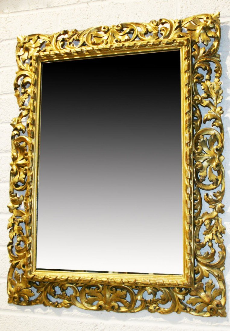 715: An ornate carved Florentine gilt Mirror Frame, 19t