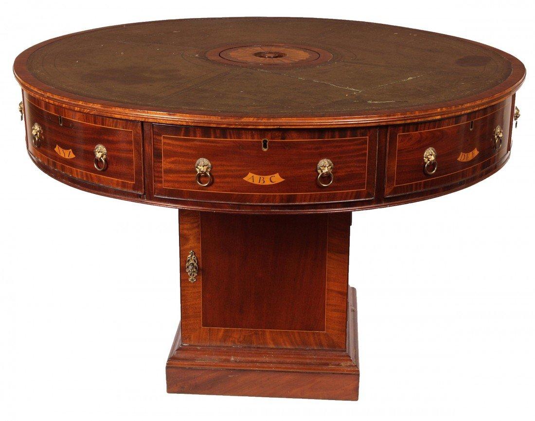 1127: A circular inlaid and rosewood banded mahogany li