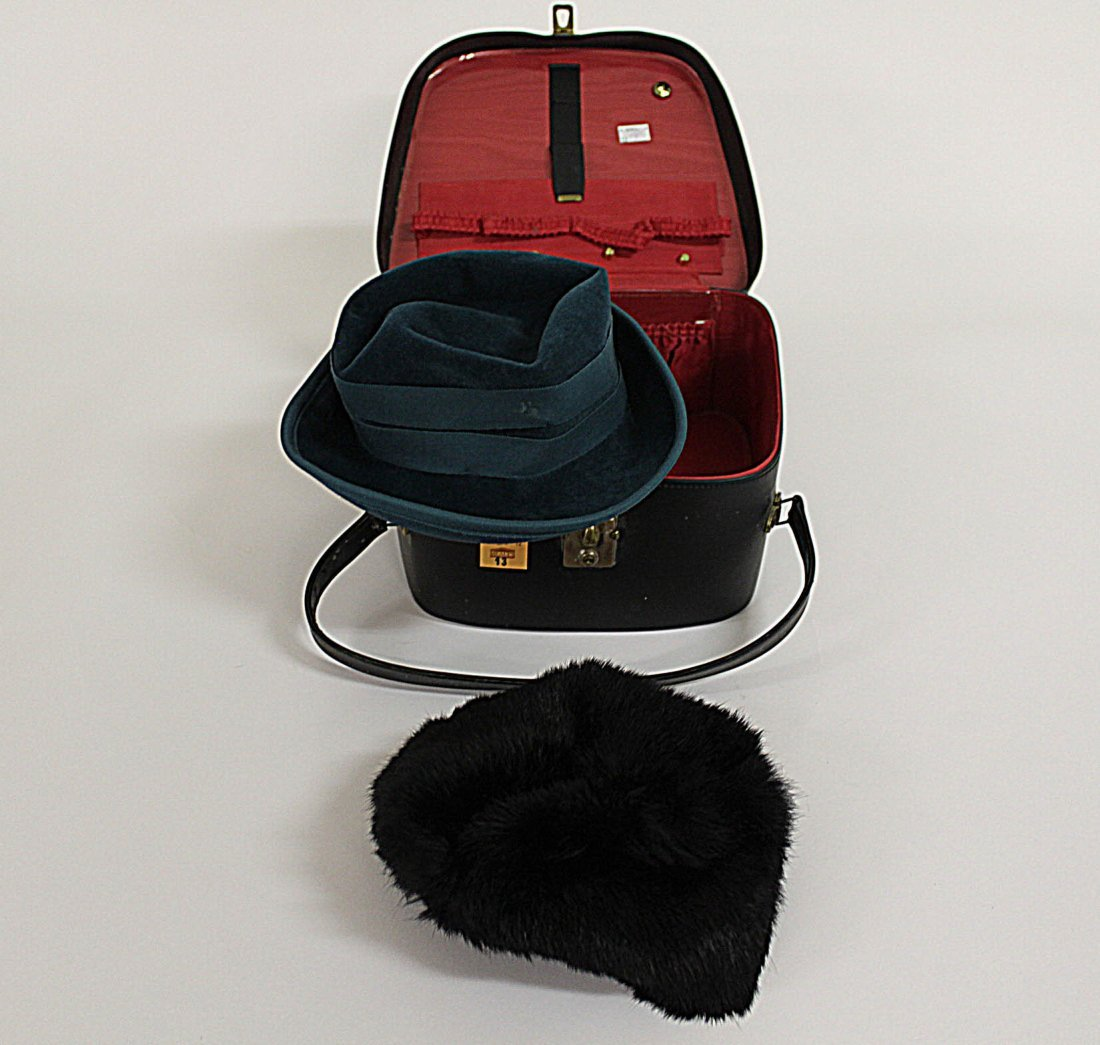 13: A ladies fur hat together with a ladies turquoise h