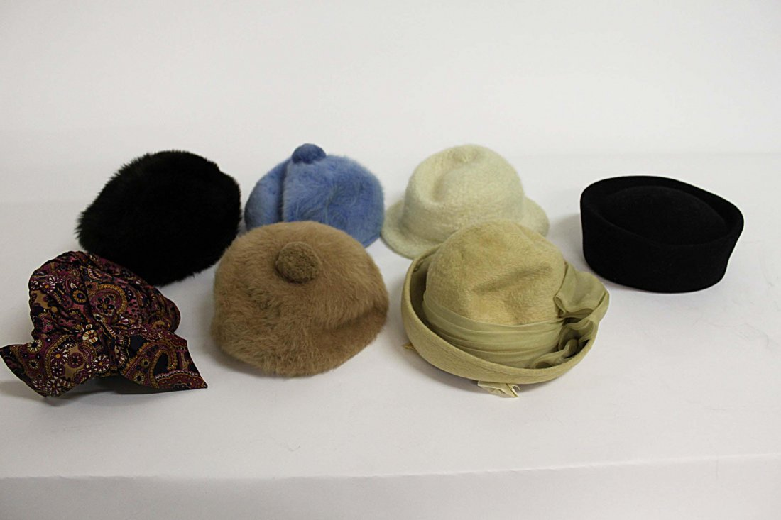 20: A selection of vintage hats, presented in two pink