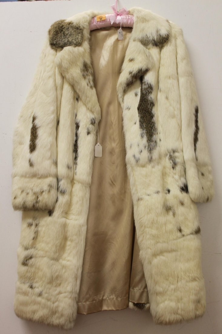 22: A cream and brown ladies mink coat, size 12/14. (1)