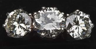 188: A fine three-stone diamond ring,  on 18ct white go