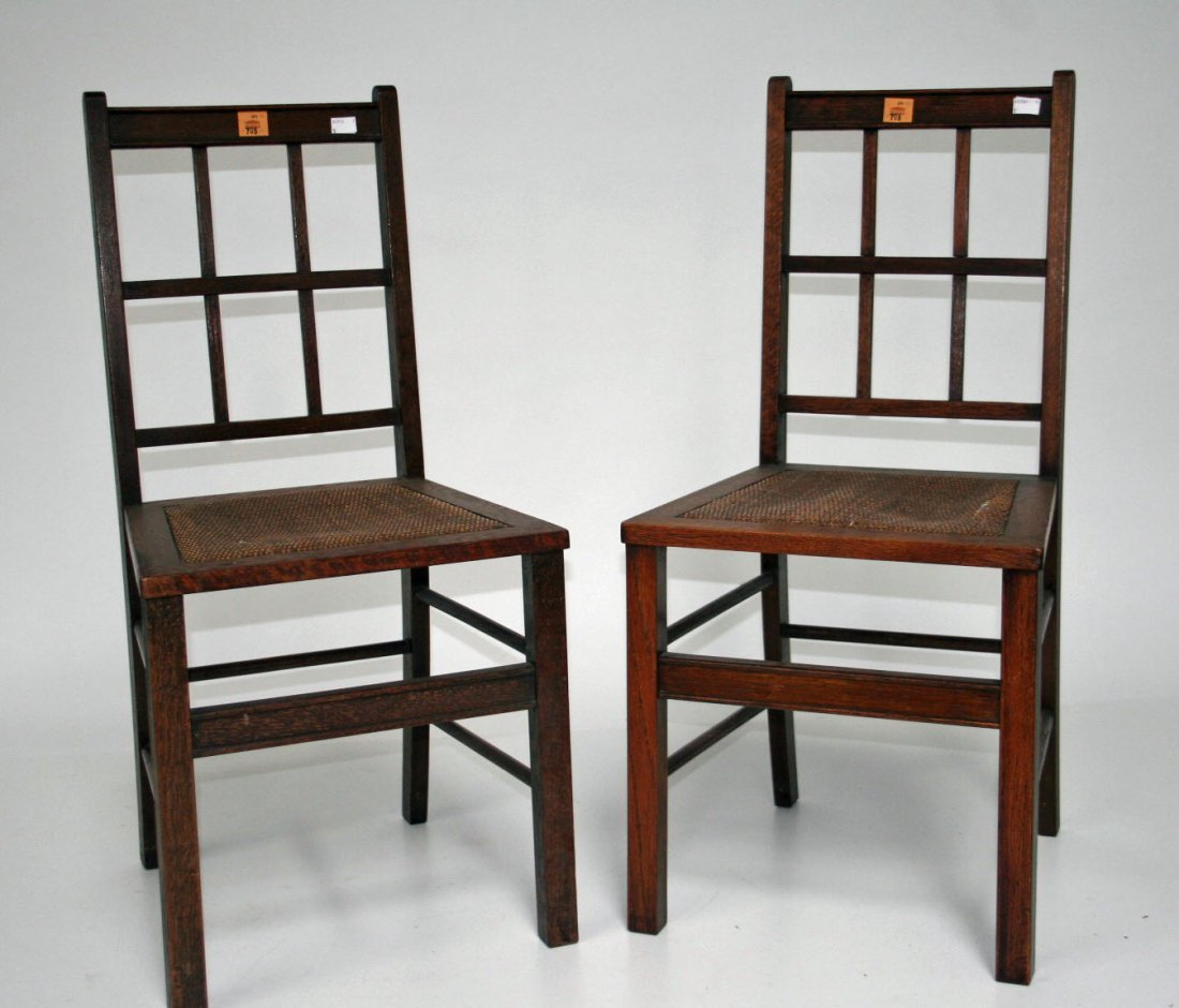 705: A pair of oak side chairs, early 20th century, eac