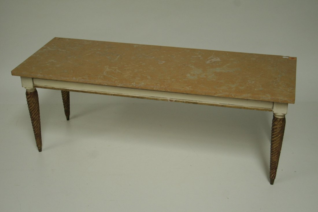 709: An oblong painted and parcel gilt occasional table