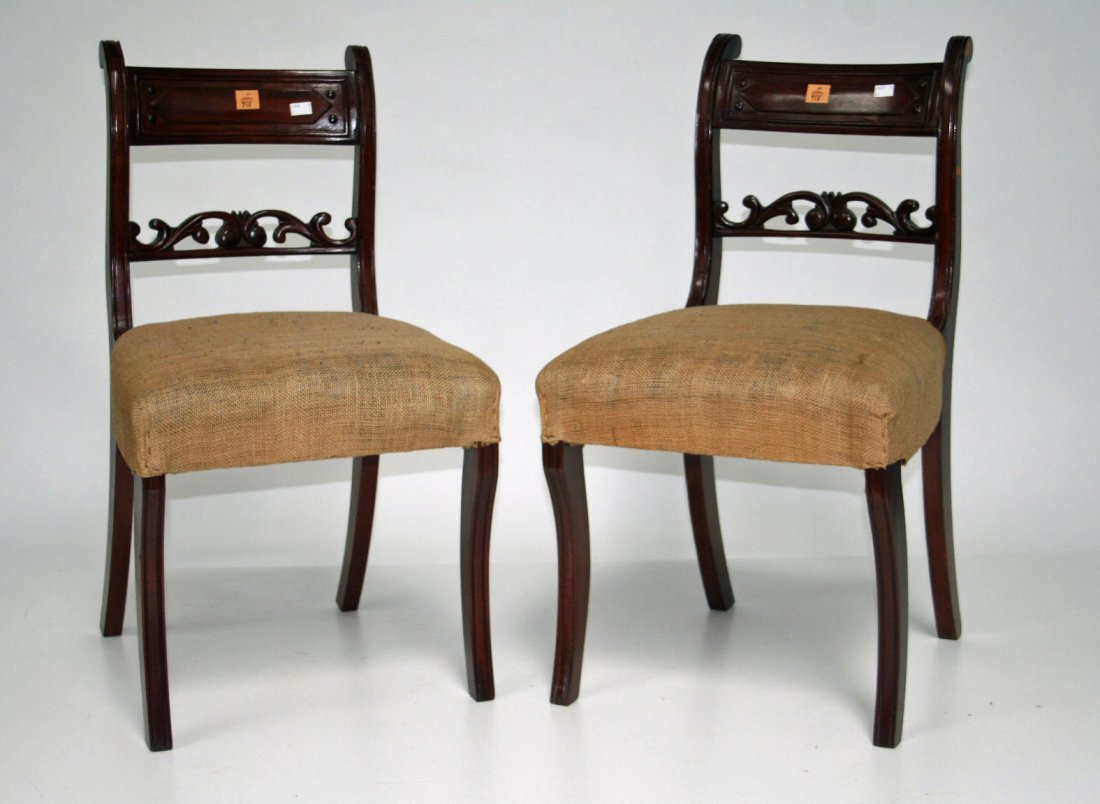 714: A set of 8 mahogany dining chairs, each with a cur