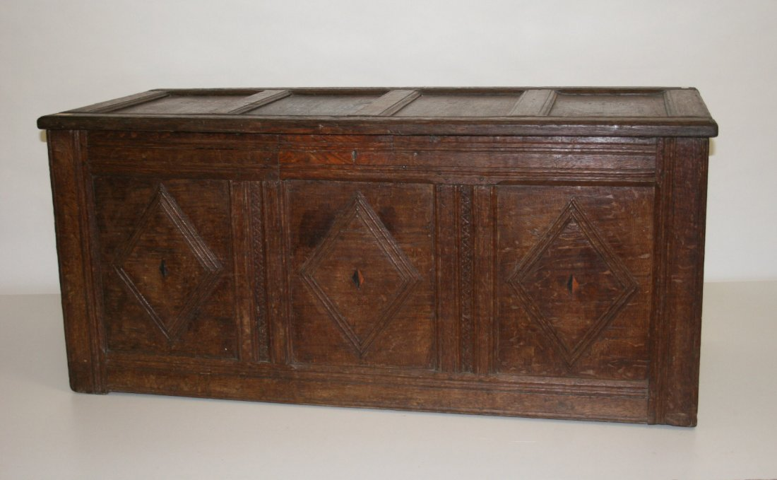 722: A heavy oak coffer, 18th century, with four panel