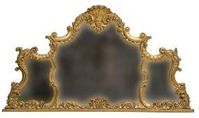 1013 A large carved gilt wood overmantel the shell cr