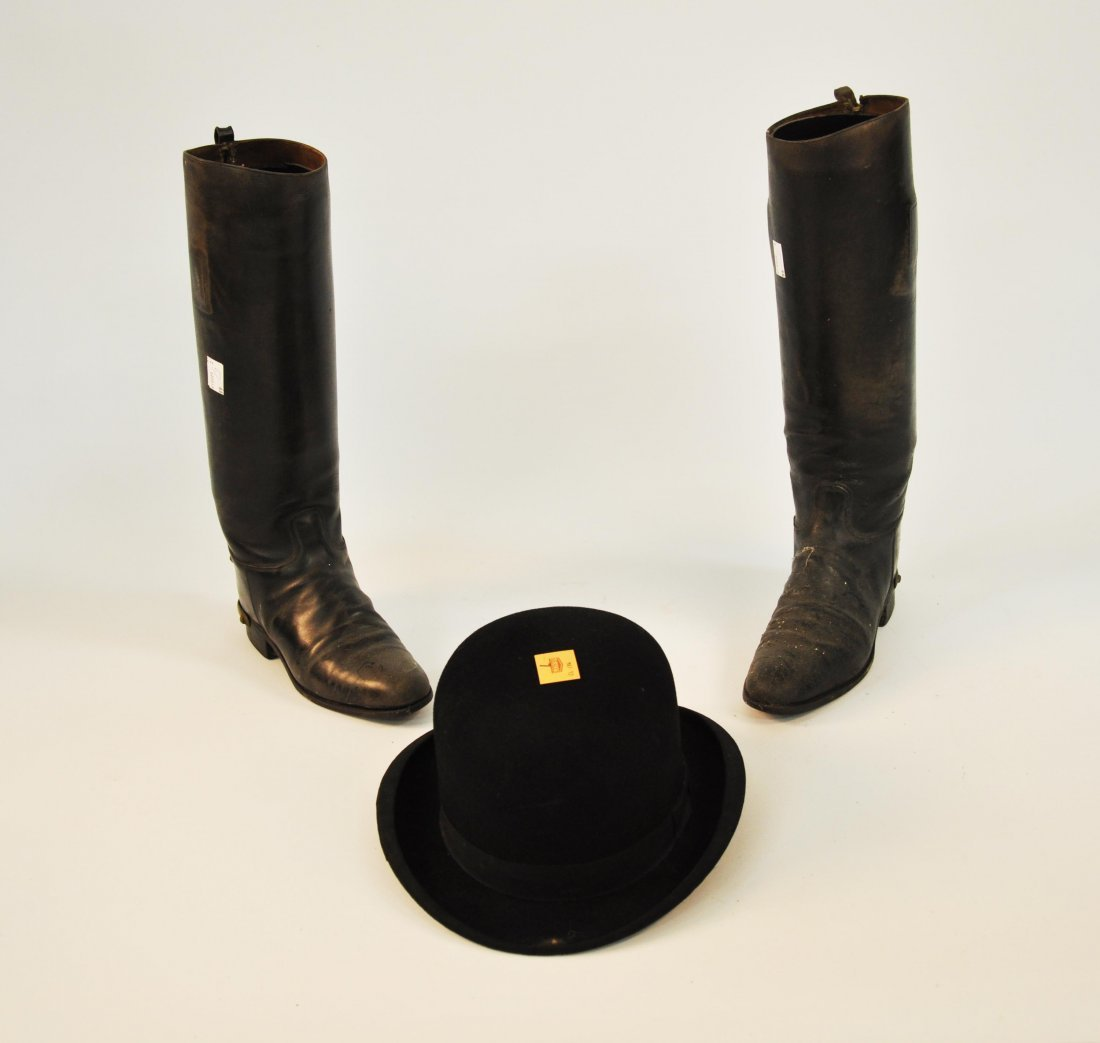 7: A pair of ladies leather riding boots, each with bra