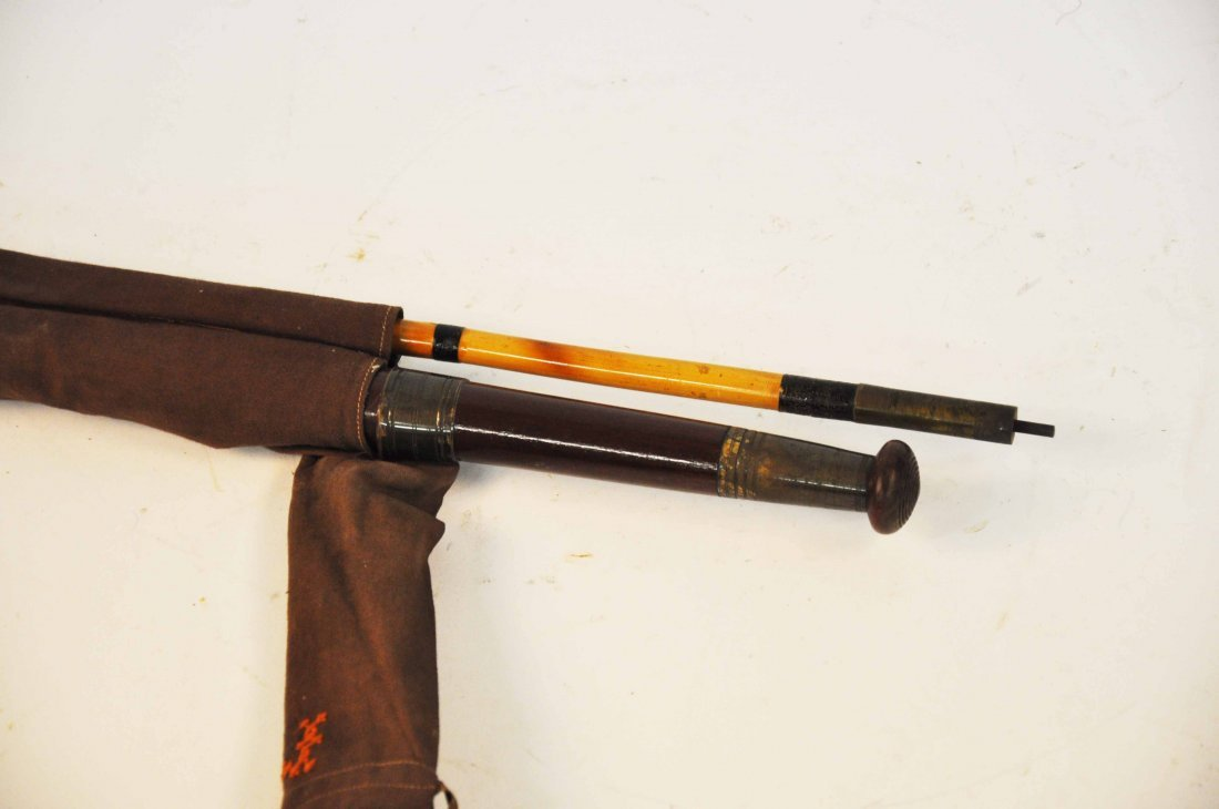 13: A 14' Greenheart three-piece bamboo salmon rod, wit