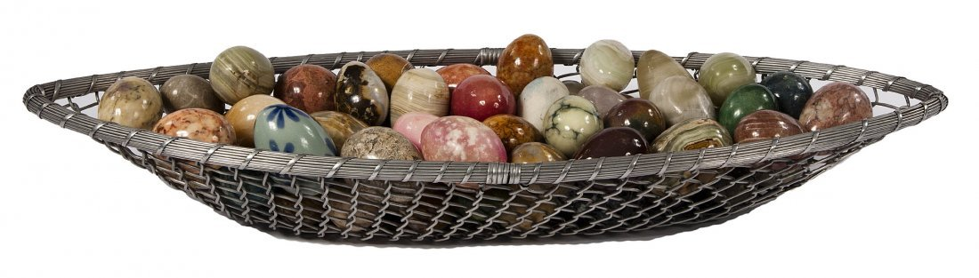 24: A collection of exotic marble eggs, in various colo