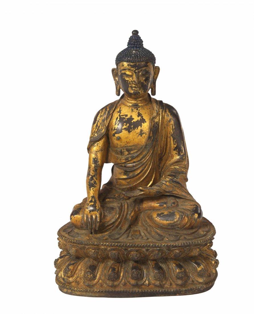 428: A gilt bronze Buddha,  possibly 17th century Tibet