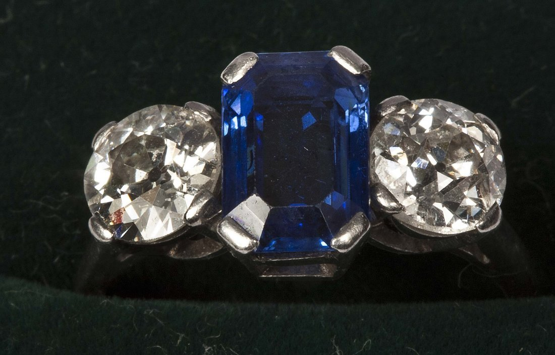 530: A sapphire and diamond three-stone ring, the sapph