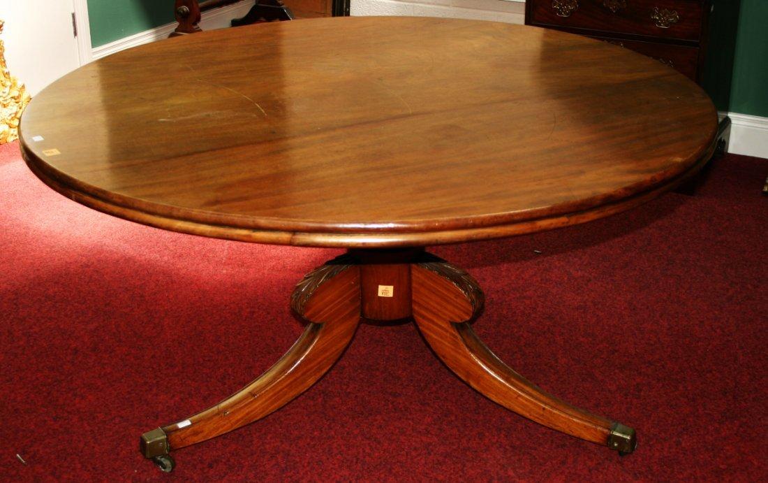 601: A circular mahogany breakfast table, Regency perio