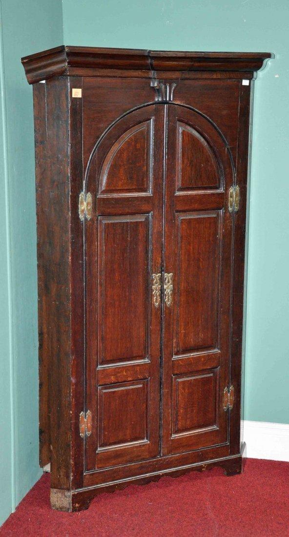 608: An oak corner cupboard, in the 18th century style,